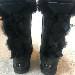 Black UGG boots with bows up the back
